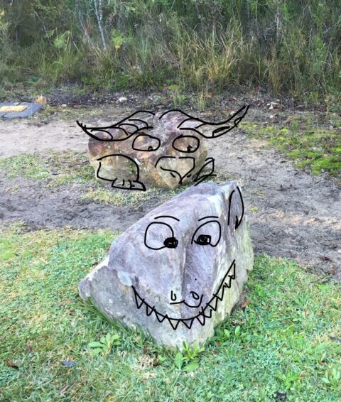 monsters drawn on rocks