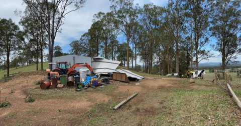 the machinery shed after the cyclone ,  was moved onto the driveway